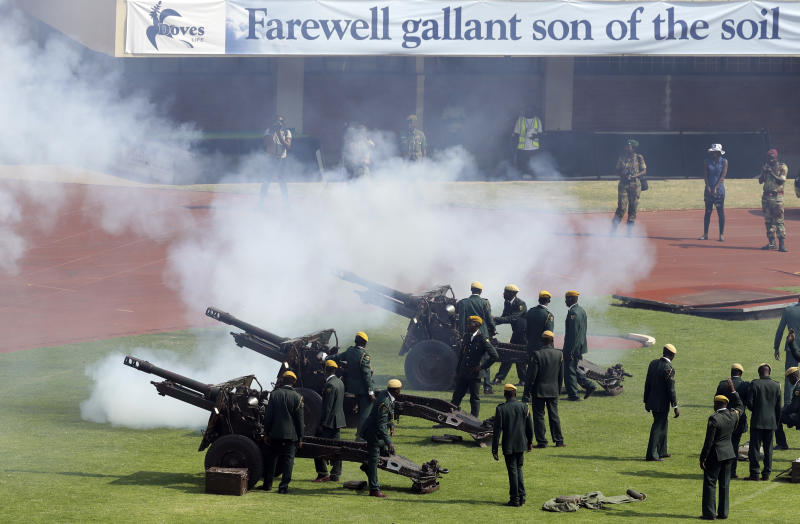 Zimbabwean military officers fired a 21-gun salute to honor the late former president Robert Mugabe during a state funeral at the National Sports Stadium in Harare, Zimbabwe, Saturday, Sept. 14, 2019. African heads of state and envoys gathered to attend a state funeral for Zimbabwe's founding president, Robert Mugabe, whose burial has been delayed for at least a month until a special mausoleum can be built for his remains. (AP Photo/Themba Hadebe)