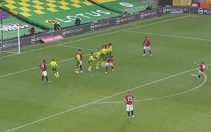 Norwich defender moves as Fernandes strikes  ball