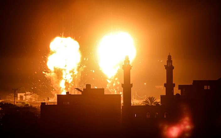 Flames are seen after an Israeli air strike hit Hamas targets in Gaza City, - Anadolu