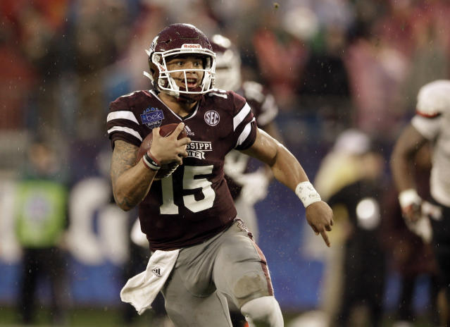 As a star at Mississippi State, Dak Prescott received a fourth-round draft grade from the Cowboys. (AP Photo/Nell Redmond)