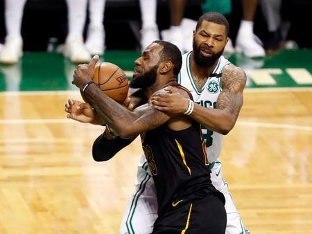 May 23, 2018; Boston, MA, USA; Boston Celtics forward Marcus Morris (13) fouls Cleveland Cavaliers forward LeBron James (23) during the third quarter of game five of the Eastern conference finals of the 2018 NBA Playoffs at TD Garden. Mandatory Credit: Winslow Townson-USA TODAY Sports