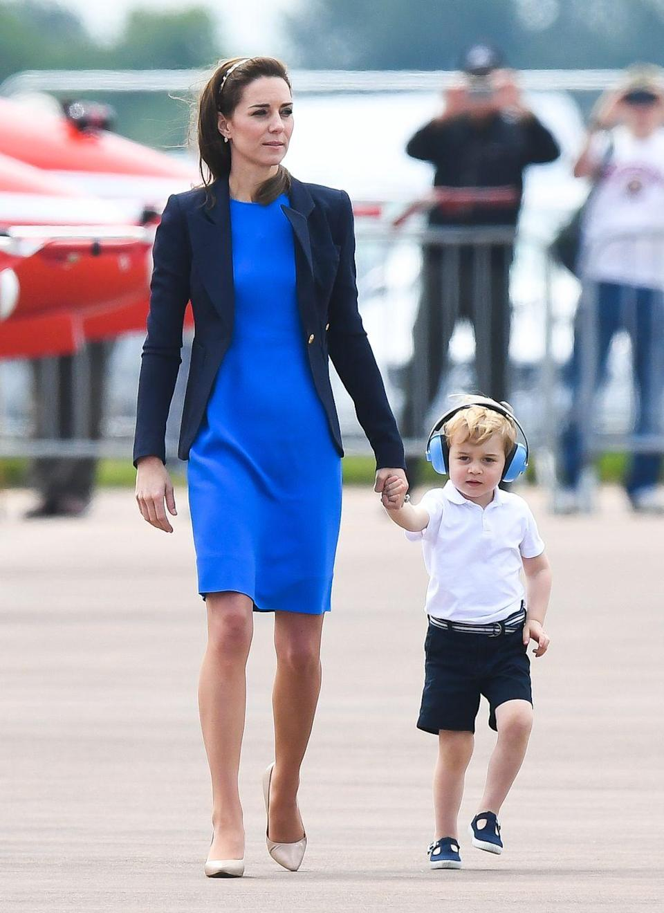 <p>The Duchess of Cambridge wore her go-to navy blue blazer on top of a cobalt blue shift dress to attend the The Royal International Air Tattoo at RAF Fairford on July 8, 2016.</p>
