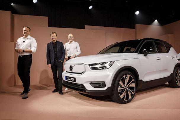 PHOTO: Volvo executives stand for a photograph next to the XC40 Recharge electric sports utility vehicle during an unveiling event in Los Angeles, Oct. 16, 2019. (Bloomberg via Getty Images, FILE)