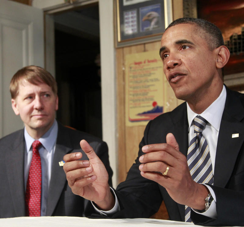 President Barack Obama, accompanied by Richard Cordray, speaks as he visits with William and Endia Eason, not pictured, Wednesday, Jan. 4, 2012, at their home in Cleveland, Ohio.  In a defiant display of executive power, President Barack Obama on Wednesday will buck GOP opposition and name Cordray as the nation's chief consumer watchdog. Outraged Republican leaders in Congress suggested that courts would determine the appointment was illegal. (AP Photo/Haraz N. Ghanbari)