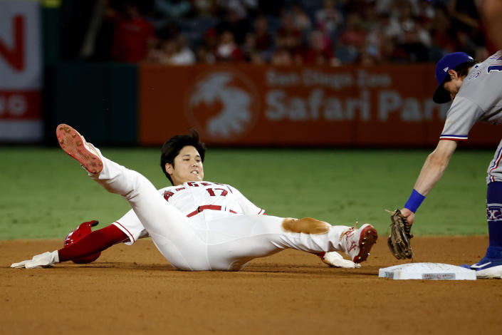 Los Angeles Angels' Shohei Ohtani, left, is tagged out by Texas Rangers' Nick Solak at second during the eighth inning of a baseball game in Anaheim, Calif., Saturday, Sept. 4, 2021. (AP Photo/Ringo H.W. Chiu)