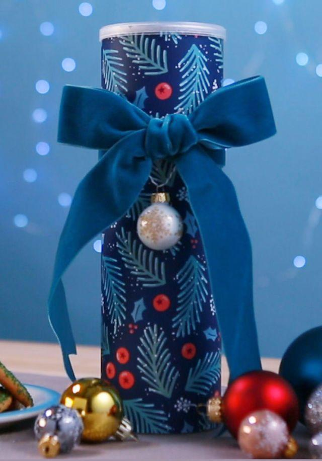 """<p>Once you pop, you just can't stop — so don't and save the can. They make the cutest cookie cans ever when you add pretty paper and ribbon!</p><p><em><a href=""""https://www.goodhousekeeping.com/holidays/christmas-ideas/a41978/diy-pringles-can-holiday-cookie-container/"""" rel=""""nofollow noopener"""" target=""""_blank"""" data-ylk=""""slk:Get the tutorial »"""" class=""""link rapid-noclick-resp"""">Get the tutorial »</a></em></p>"""