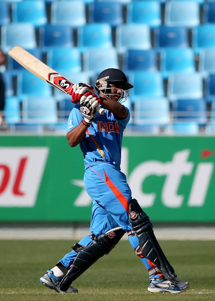 DUBAI, UNITED ARAB EMIRATES - FEBRUARY 15:  Akhil Herwader of India bars during the ICC U19 Cricket World Cup 2014 match between India and Pakistan at the Dubai Sports City Cricket Stadium on February 15, 2014 in Dubai, United Arab Emirates.  (Photo by Francois Nel - IDI/IDI via Getty Images)