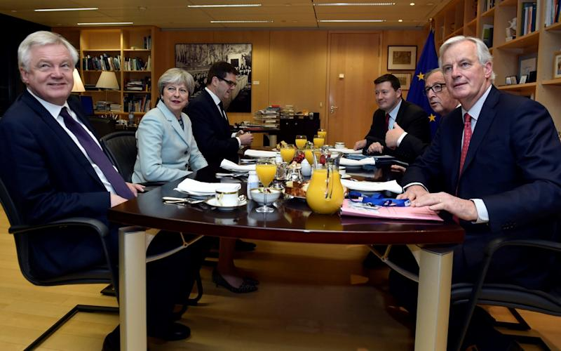 David Davis, Theresa May, European Commission President Jean-Claude Juncker and European Union's chief Brexit negotiator Michel Barnier meet at the European Commission in Brussels on Friday morning - REUTERS