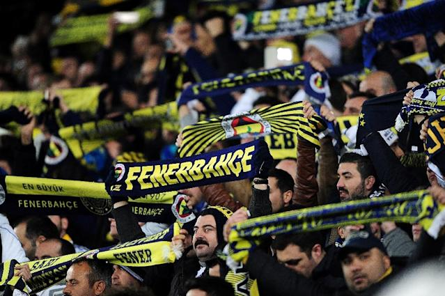 Fenerbahce fans cheer their team before start the Turkish Sport Toto Super League football match Fenerbahce vs Galatasaray at the Fenerbahce Sukru Saracoglu Stadium, in Istanbul, on March 8, 2015 (AFP Photo/Ozan Kose)