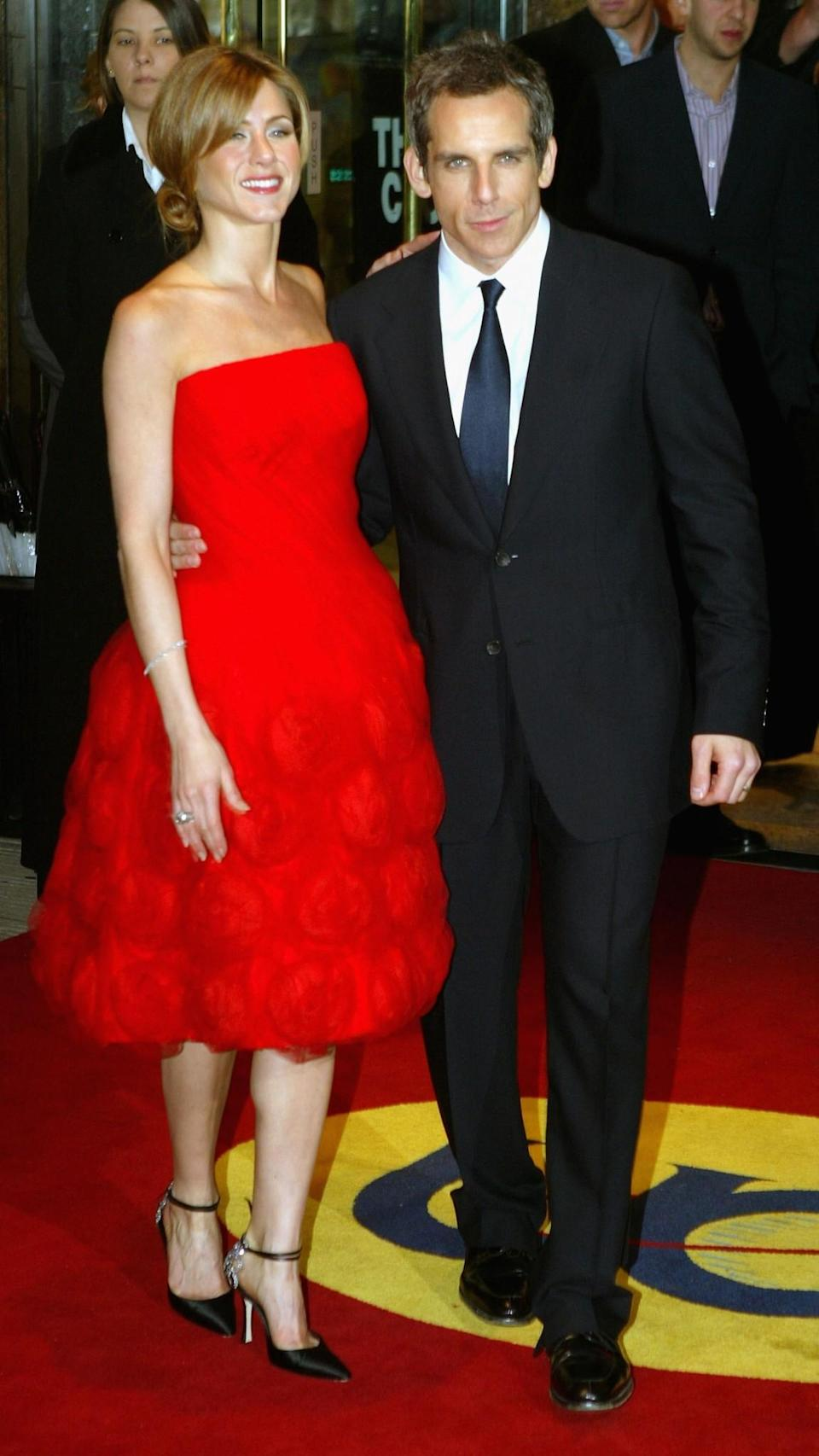 <p>A move away from Jennifer's usual slinky dresses saw the actress in a red floral mid-length dress. <i>[Photo: Getty]</i> </p>