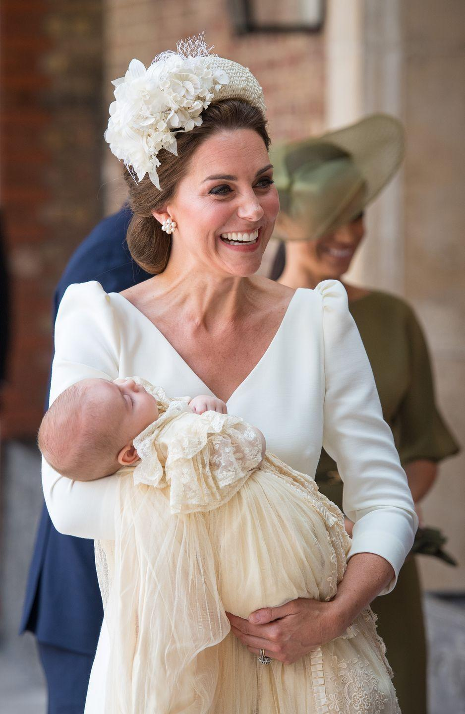 <p>Arriving at St. James's Palace in London for Prince Louis's christening service, Middleton wore a white puffed sleeve dress and an ornate hatband. </p>