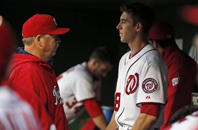Washington Nationals pitching coach Steve McCatty, left, talks with starting pitcher Taylor Jordan in the dugout during the first inning of a baseball game at Nationals Park, Thursday, April 17, 2014, in Washington. (AP Photo/Alex Brandon)
