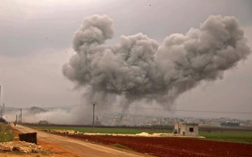 A large plume of smoke billows into the air above the rebel-held town of Atareb as government forces keep up their bombardment