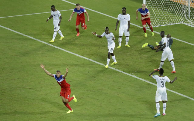 United States' John Brooks, bottom left, celebrates scoring his side's second goal during the group G World Cup soccer match between Ghana and the United States at the Arena das Dunas in Natal, Brazil, Monday, June 16, 2014. The United States defeated Ghana 2-1. (AP Photo/Hassan Ammar)