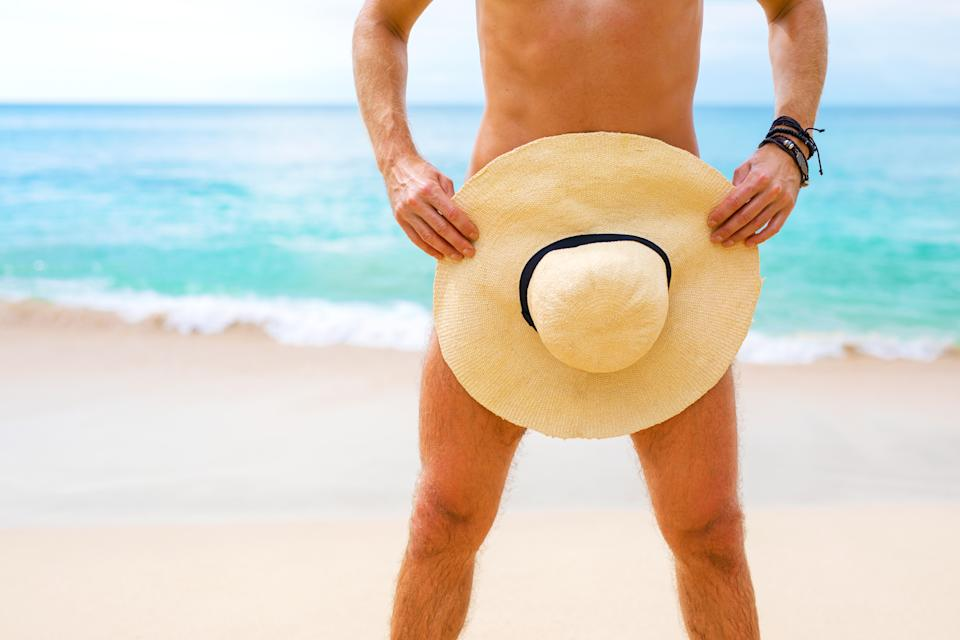 Close-up photo of man covering himself with summer hat