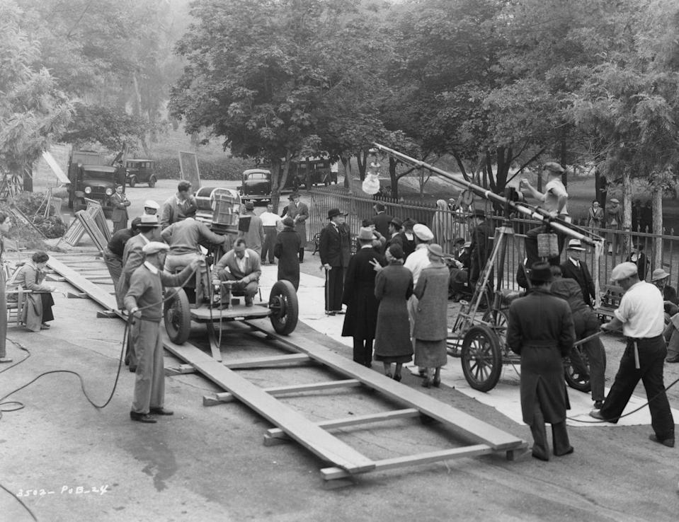 <p>As Hollywood has evolved, so too has the filmmaking industry. In order to shoot moving cars in the mid-1900s, film crews had to build tracks, as pictured here.</p>
