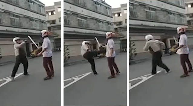 A quick kick snapped the bat in half, leaving the attacker stunned. Photo: YouTube