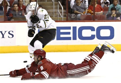 Phoenix Coyotes' David Schlemko (6) dives in front of the puck as Dallas Stars' Loui Eriksson (21), of Sweden, tries to get a shot off during the first period in an NHL hockey game Saturday, Feb. 2, 2013, in Glendale, Ariz. (AP Photo/Ross D. Franklin)