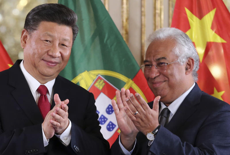 China's President Xi Jinping and Portuguese Prime Minister Antonio Costa, right, applaud after the signing of agreements between the two governments Wednesday, Dec. 5, 2018, at the Queluz National Palace in Queluz, outside Lisbon. Xi closes Wednesday a two-day state visit to Portugal with the two countries signing a memorandum of understanding on cooperation within China's modern Silk Road initiative, with special emphasis on transport connections and energy. (AP Photo/Armando Franca)