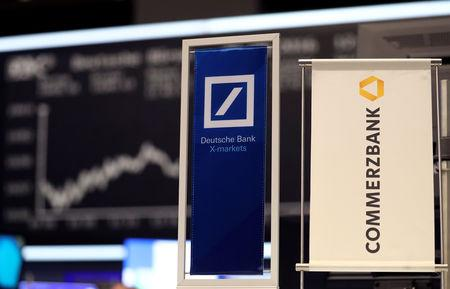 FILE PHOTO: Banners of Deutsche Bank and Commerzbank are pictured in front of the German share price index, DAX board, at the stock exchange in Frankfurt, Germany, September 30, 2016. REUTERS/Kai Pfaffenbach/File Photo