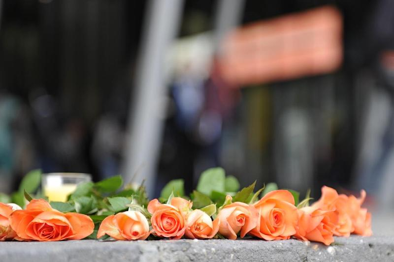 Flowers are laid outside Melbourne Convention and Exhibition Centre (MCEC) to remember those lost onboard Malaysia Airlines flight MH17, on July 19, 2014 (AFP Photo/Esther Lim)