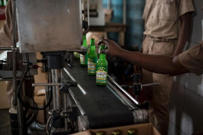 The Nkulenu factory in Accra exports Ghanaian food and drink, including palm wine (AFP Photo/CRISTINA ALDEHUELA)