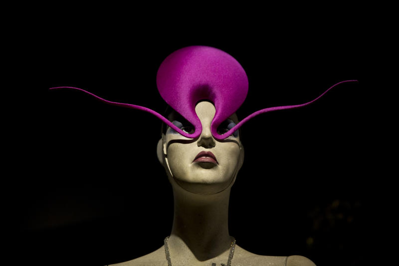 """The Philip Treacy """"Shocking Pink Roswell Hat"""" is displayed at the press view of the """"Isabella Blow: Fashion Galore!"""" exhibition in London, Tuesday, Nov. 19, 2013. The exhibition, which runs from November 20 to March 2, celebrates the life and wardrobe of the late British patron of fashion and art who discovered many young fashion design talents. (AP Photo/Matt Dunham)"""