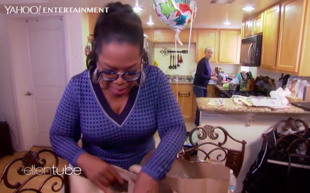 Oprah and Ellen attempt to cook dinner for a woman they met at the grocery store. (Photo: NBC)