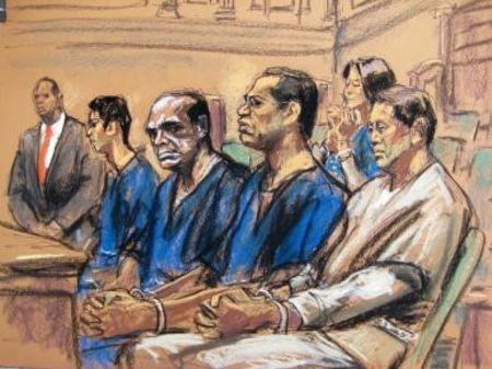 Jeff Yin (2nd L), John Ashe, Francis Lorenzo (2nd R) and Ng Lap Seng (R) along with Sheri Yan (back) are pictured seated in court in New York in this court sketch October 22, 2015. REUTERS/Jane Rosenberg