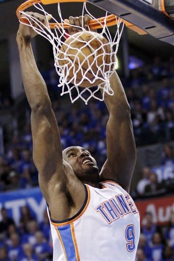 Oklahoma City Thunder power forward Serge Ibaka (9), from the Republic of Congo, dunks against the San Antonio Spurs during the first half of Game 3 in their NBA basketball Western Conference finals playoff series, Thursday, May 31, 2012, in Oklahoma City. (AP Photo/Sue Ogrocki)