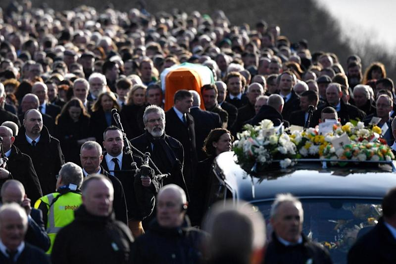 Procession: Sinn Fein President Gerry Adams walks with the funeral cortege leaves St Columba's Church (Getty Images)