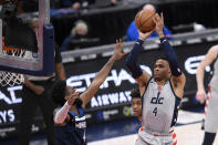 Washington Wizards guard Russell Westbrook, right, shoots against Minnesota Timberwolves guard Jaylen Nowell, left, during the first half of an NBA basketball game, Saturday, Feb. 27, 2021, in Washington. (AP Photo/Nick Wass)