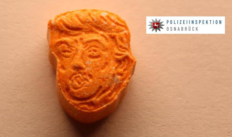 This undated picture provided by Polizeiinspektion Osnabrueck police shows an ecstasy pill. German police say they have seized thousands of ecstasy pills in the shape of President Donald Trump's head, a haul with an estimated street value of 39,000 euros ($45,900). Police in Osnabrueck, in northwestern Germany, say they found the drugs during a check Saturday evening on an Austrian-registered car on the A30 highway. (Police Osnabrueck via AP)