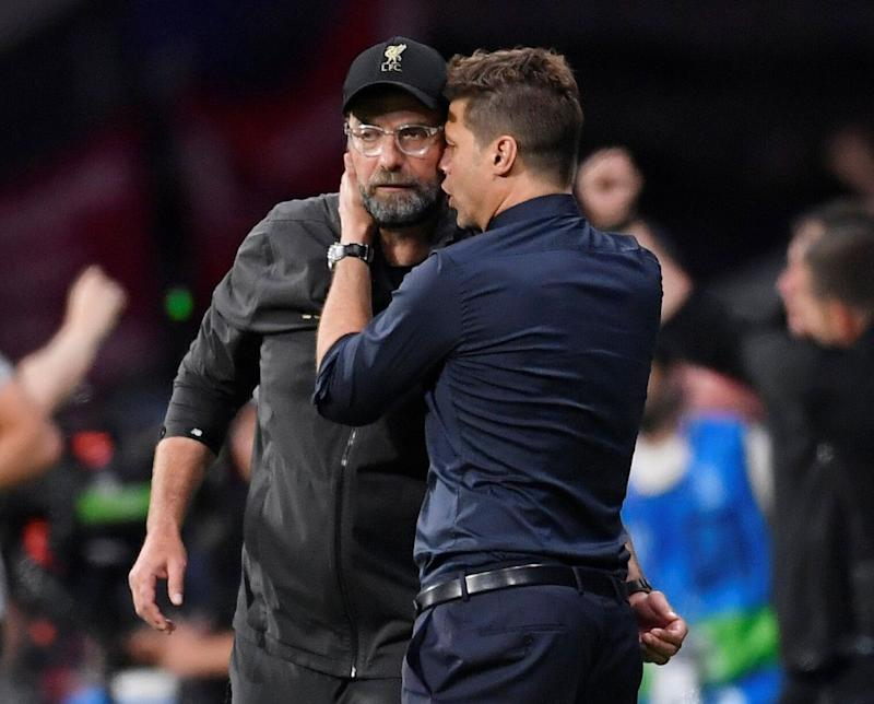 Soccer Football - Champions League Final - Tottenham Hotspur v Liverpool - Wanda Metropolitano, Madrid, Spain - June 1, 2019 Liverpool manager Juergen Klopp and Tottenham manager Mauricio Pochettino embrace after the match REUTERS/Toby Melville