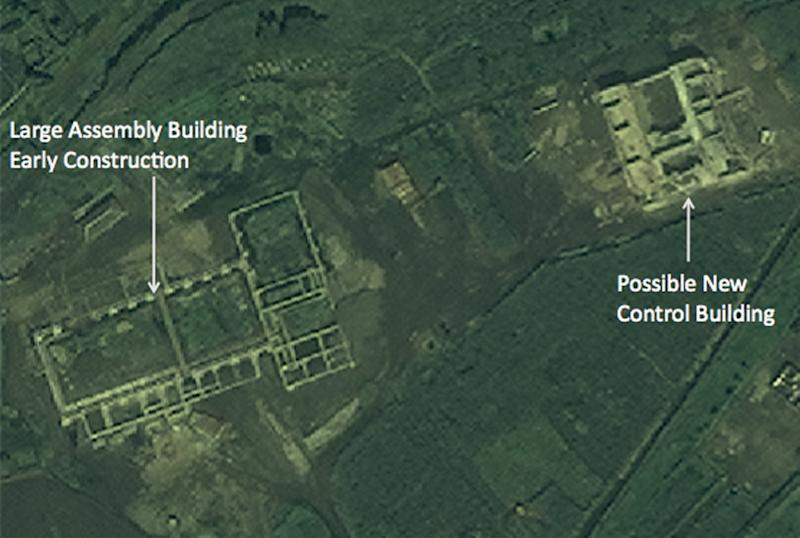 In this satellite image taken Aug. 29, 2012 by DigitalGlobe and provided Monday, Sept. 24, 2012 by 38 North, the website of the U.S.-Korea Institute at Johns Hopkins School of Advanced International Studies, structures which an analyst says a newly commenced construction site of what is probably a new rocket launch control center for the entire Tonghae launch complex and a large, still unfinished rocket assembly building are seen near the village of Musudan-ri on the northeast coast of North Korea. North Korea has stopped construction on the launch pad where intercontinental-range rockets could be tested, an interruption possibly due to heavy rains and that could stall completion up to two years, according to the analysis of Aug. 29 images provided to The Associated Press by 38 North. (AP Photo/DigitalGlobe) NO SALES, MANDATORY CREDIT