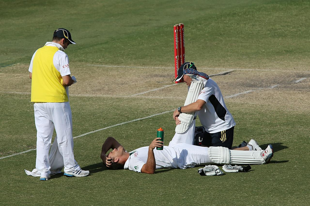ADELAIDE, AUSTRALIA - NOVEMBER 26: Faf du Plessis of South Africa receives treatment in the last few overs of the day during day five of the Second Test Match between Australia and South Africa at Adelaide Oval on November 26, 2012 in Adelaide, Australia.  (Photo by Morne de Klerk/Getty Images)