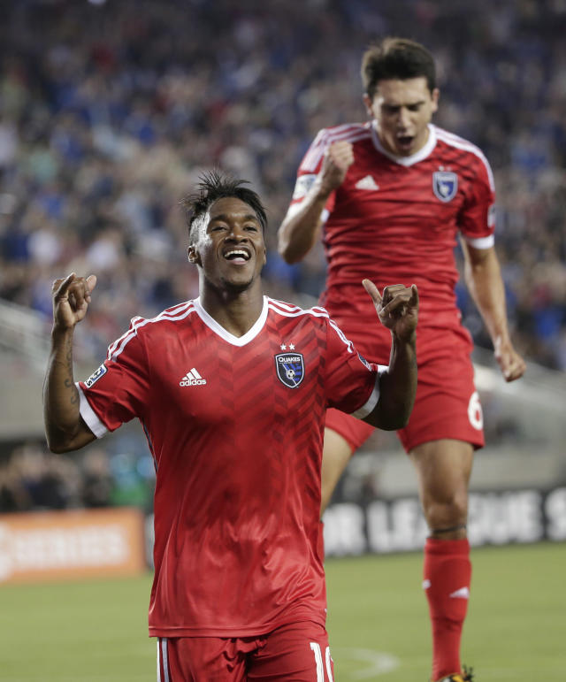 San Jose Earthquakes' Yannick Djalo, left, celebrates his goal with teammate Shea Salinas during the first half of an MLS soccer match against the Seattle Sounders on Saturday, Aug. 2, 2014, in Santa Clara, Calif. (AP Photo/Marcio Jose Sanchez)