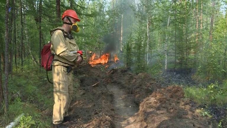 Exhausted firefighters battle Siberia blazes