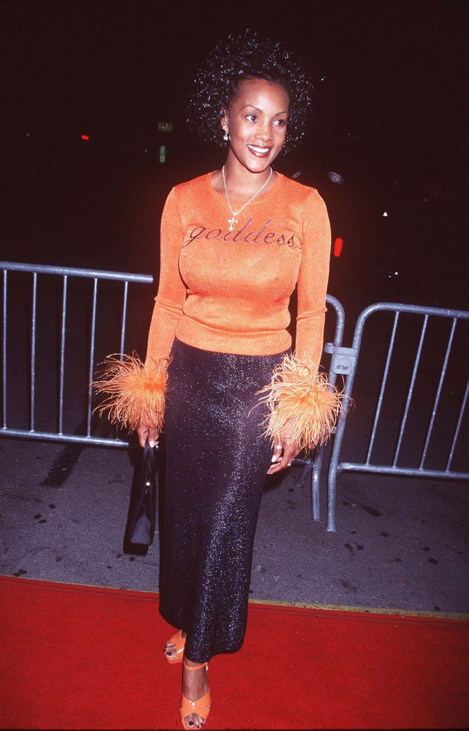 """<p>While Vivica A. Fox is, no doubt, a goddess, this is... a lot. This shimmering orange top not only says """"goddess"""" splashed across the front, but it even has feathered wrists. <br></p>"""