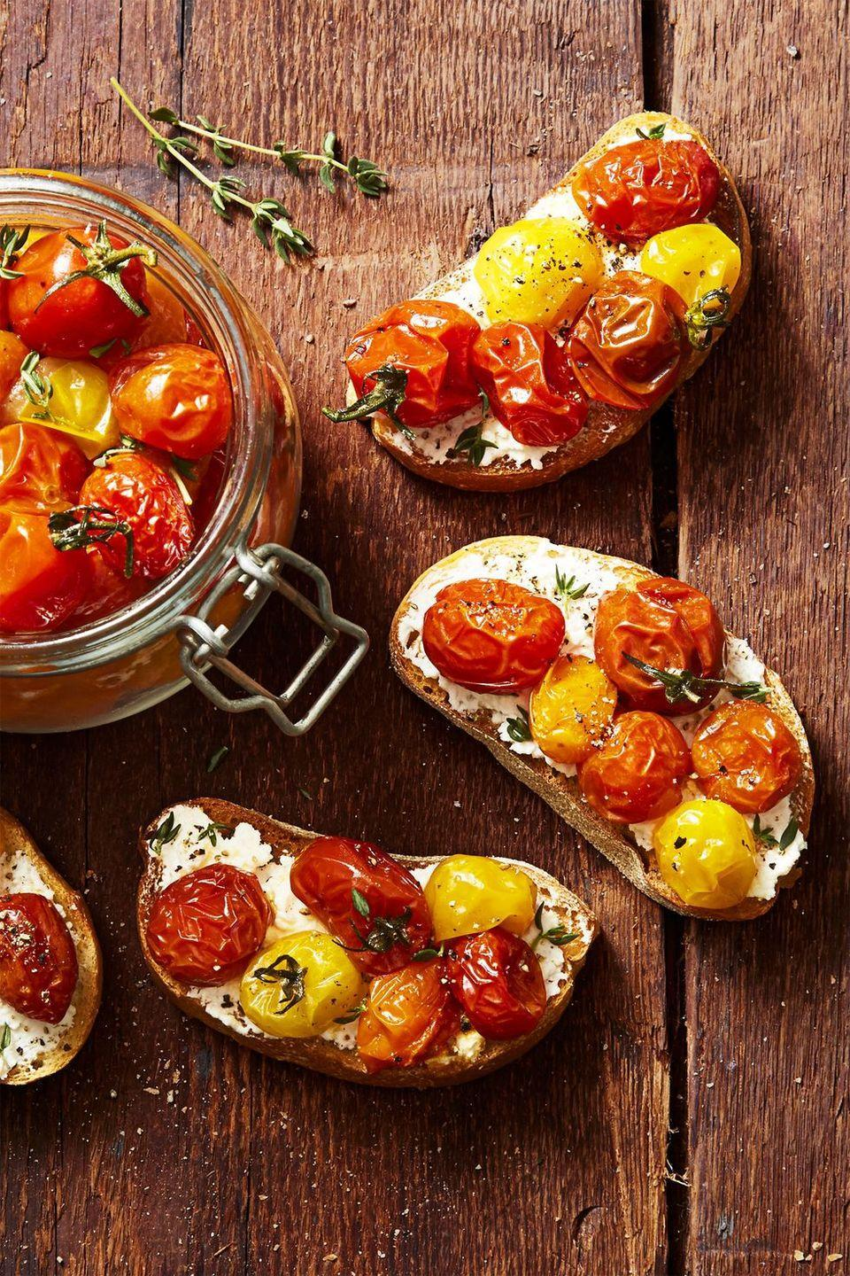 """<p>These bruschetta apps look super swanky, but all they require are a few roast veggies. </p><p><em><a href=""""https://www.goodhousekeeping.com/food-recipes/a45216/cherry-tomato-confit-recipe/"""" rel=""""nofollow noopener"""" target=""""_blank"""" data-ylk=""""slk:Get the recipe for Cherry Tomato Confit »"""" class=""""link rapid-noclick-resp"""">Get the recipe for Cherry Tomato Confit »</a></em></p>"""