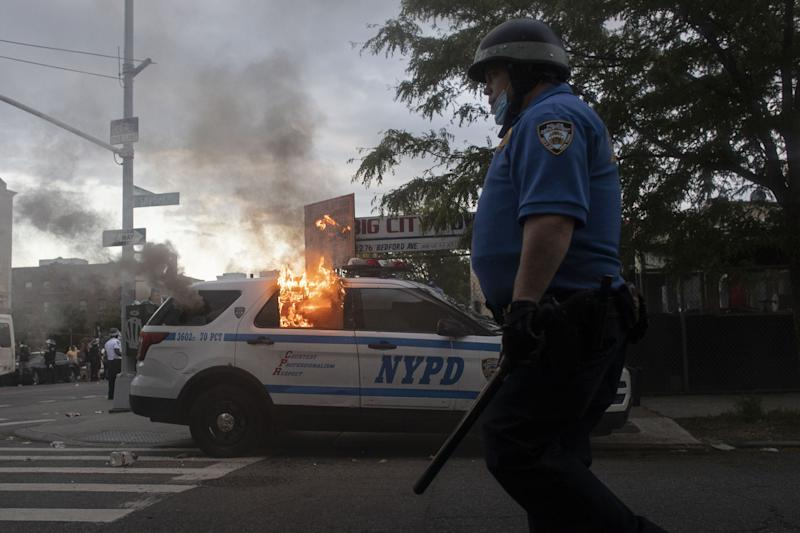 Protesters in New York City set a police vehicle on fire on May 30, 2020 during a protest following the death of George Floyd in Minneapolis.