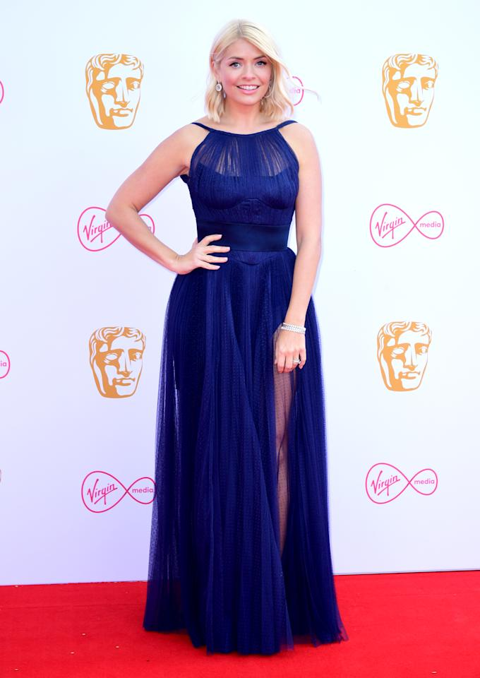 The 'This Morning' presenter wore a midnight blue gown by Maria Lucia Hohan at the Virgin Media British Academy Television Awards at The Royal Festival Hall on May 12, 2019 in London, England. <em>[Photo: PA]</em>