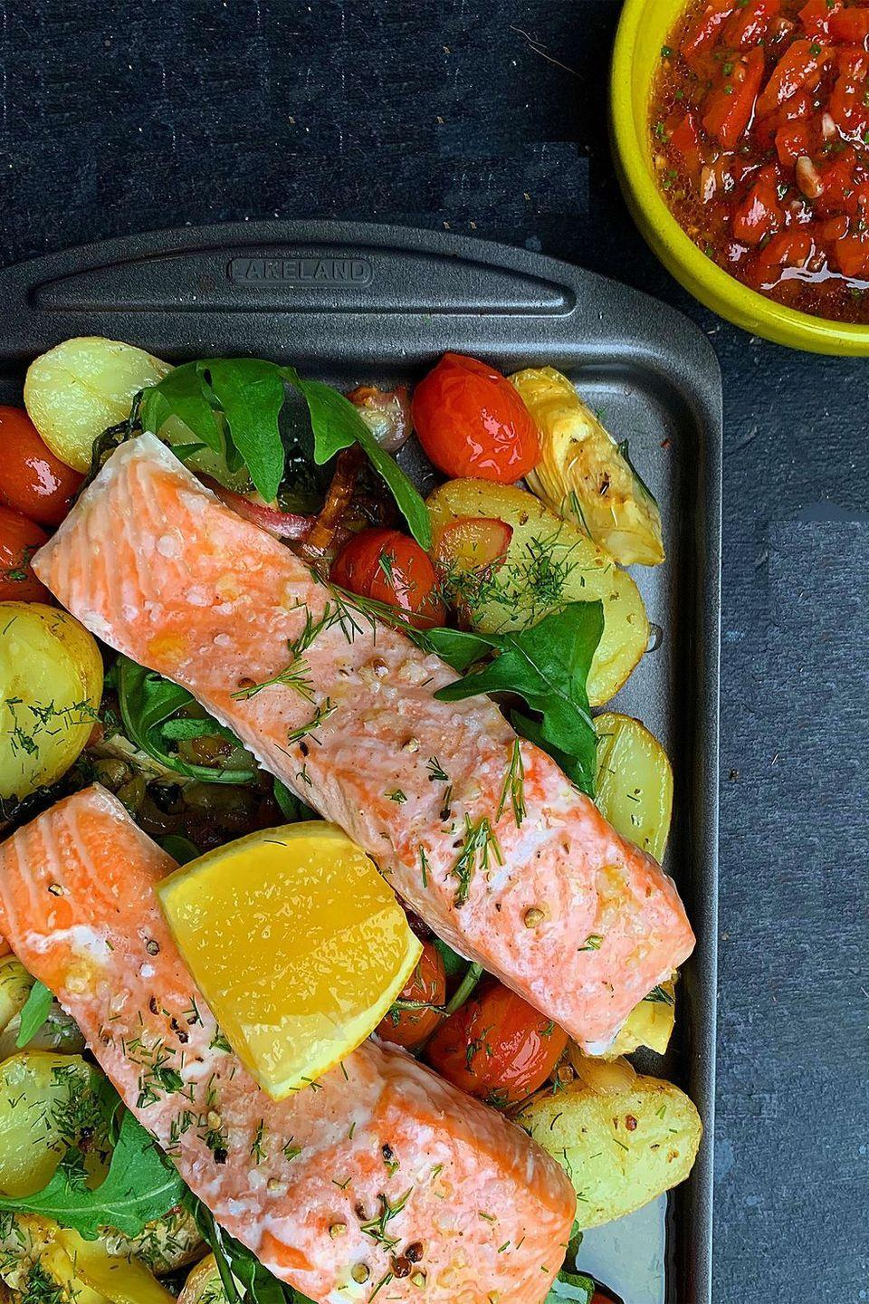 """<p>If you're after an easy, tasty and <a href=""""https://www.delish.com/uk/cooking/recipes/g29871554/healthy-dinner-recipes/"""" rel=""""nofollow noopener"""" target=""""_blank"""" data-ylk=""""slk:healthy dinner"""" class=""""link rapid-noclick-resp"""">healthy dinner</a> recipe, than this <a href=""""https://www.delish.com/uk/cooking/recipes/g29843028/healthy-salmon-recipes/"""" rel=""""nofollow noopener"""" target=""""_blank"""" data-ylk=""""slk:salmon"""" class=""""link rapid-noclick-resp"""">salmon</a> traybake is the one for you. Packed full of Mediterranean antipasti style veggies like artichokes, tomatoes and olives, it's a dinner table win.</p><p>Get the <a href=""""https://www.delish.com/uk/cooking/recipes/a33619206/mediterranean-salmon-traybake/"""" rel=""""nofollow noopener"""" target=""""_blank"""" data-ylk=""""slk:Mediterranean Salmon Traybake"""" class=""""link rapid-noclick-resp"""">Mediterranean Salmon Traybake</a> recipe.</p>"""