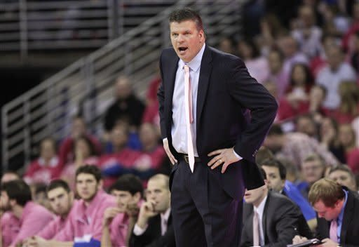 Creighton coach Greg McDermott instructs his players in the first half of their NCAA college basketball game against Bradley in Omaha, Neb., Saturday, Jan. 28, 2012. Creighton won 73-59. (AP Photo/Nati Harnik)