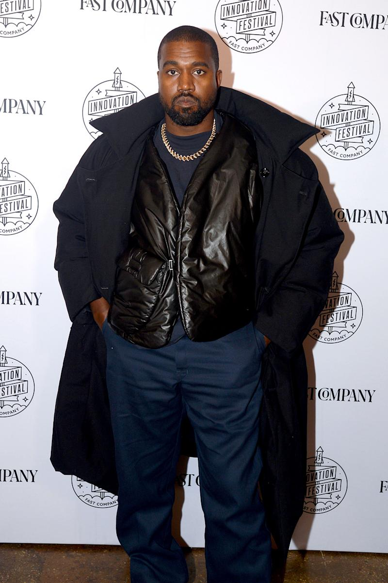 Kanye West looks adorable as he sports a blue jack with inner-wear and pant to match