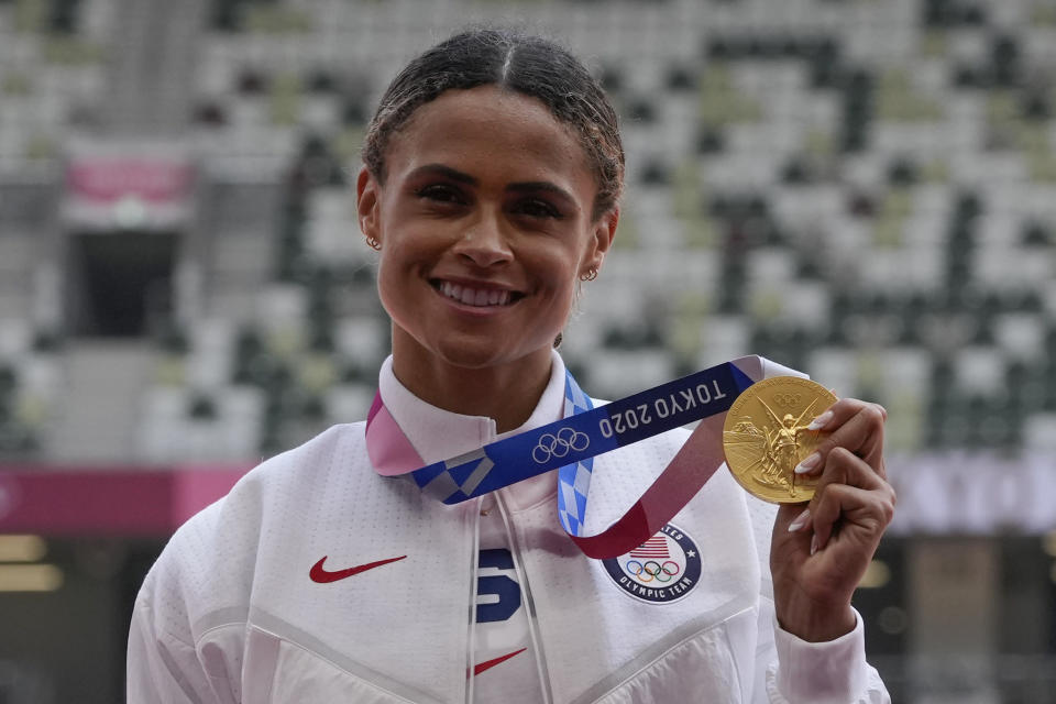 Gold medalist Sydney McLaughlin, of the United States, poses during the medal ceremony for the women's 400-meter hurdles at the 2020 Summer Olympics, Wednesday, Aug. 4, 2021, in Tokyo. (AP Photo/Francisco Seco)