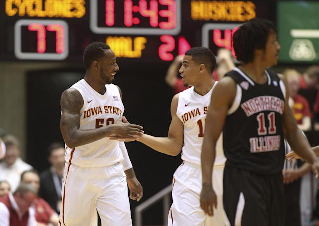 Iowa State guards DeAndre Kane (50) and Naz Long (15) celebrate after Kane forced a turnover during the second half of an NCAA college basketball game against Northern Illinois at Hilton Coliseum in Ames, Iowa, Tuesday, Dec. 31, 2013. Kane scored 16 points and had 12 assists and eight rebounds in the 99-63 win. (AP Photo/Justin Hayworth)
