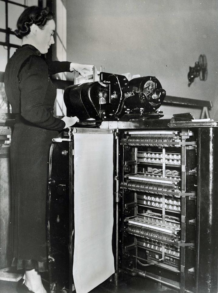 In this undated photo provided by the Franklin D. Roosevelt Presidential Library and Museum, a Census Bureau staffer operates an electric tabulator at the U.S. Census Bureau. Data for the 1940 Census was collected by hand and transferred to punched cards which were then run through the tabulating machine. The tabulating machine printed the final calculation. (AP Photo/Franklin D. Roosevelt Presidential Library Museum)