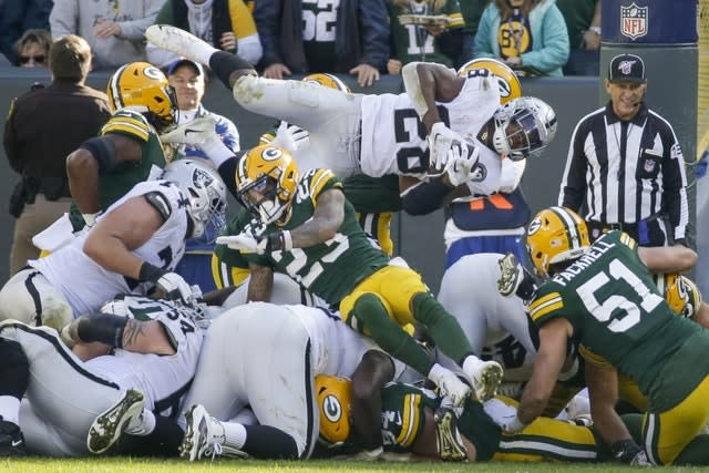 Oakland Raiders' Josh Jacobs was stopped during the second half against the Green Bay Packers on Sunday (Mike Roemer/AP)