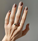 """Nail art is back, but sometimes neutral nails make just as much of a statement. Try Essie's <a href=""""https://www.ulta.com/gel-couture?productId=xlsImpprod14371015&sku=2557971&cmpid=PS_Non!google!Product_Listing_Ads&cagpspn=pla&CATCI=pla-295703662999&CAAGID=68470492483&CAWELAID=330000200001995915&CATARGETID=330000200001755814&CADevice=c&gclid=EAIaIQobChMIn5WI28-V6AIVAp-fCh0H4w-5EAQYAiABEgLPV_D_BwE"""" rel=""""nofollow noopener"""" target=""""_blank"""" data-ylk=""""slk:Wool Me Over"""" class=""""link rapid-noclick-resp"""">Wool Me Over</a> for a cool greige."""